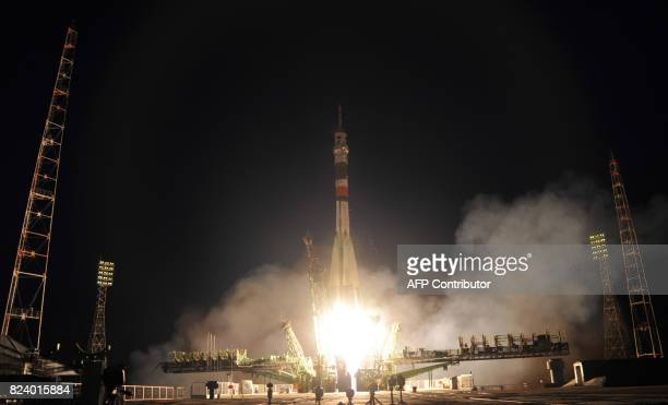 TOPSHOT Russia's Soyuz MS05 rocket carrying a threeman crew from Italy Russia and the United States blasts off on July 28 2017 from the Baikonur...