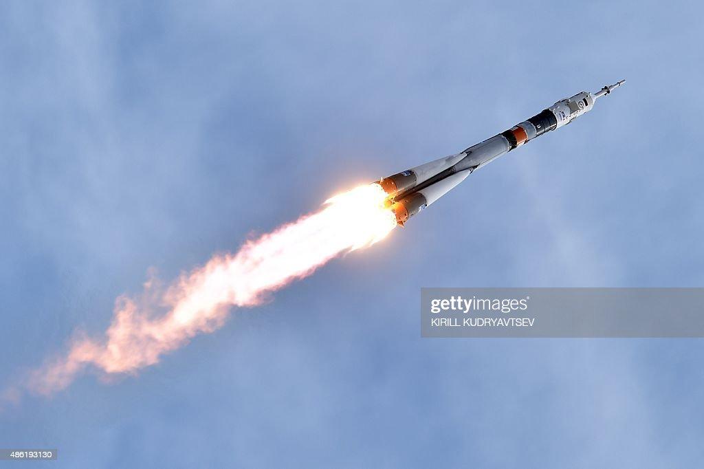 Russia's Soyuz TMA18M spacecraft carrying the International Space Station crew of Kazakhstan's cosmonaut Aydyn Aimbetov Russian cosmonaut Sergei...