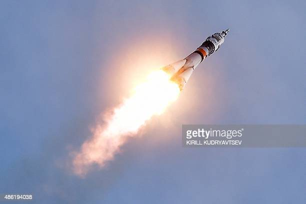 Russia's Soyuz TMA18M spacecraft carrying the International Space Station crew of Kazakhstan's cosmonaut Aydyn Aimbetov Russian cosmonaut Sergei...
