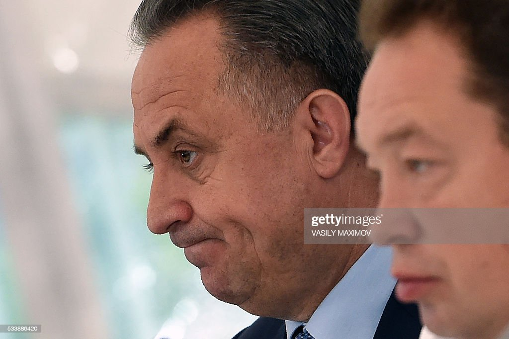 Russia's Sports Minister Vitaly Mutko (L) and the coutry's national football team head coach Leonid Slutsky attend a press conference at Moscows Sheremetyevo airport on May 24, 2016. Russias footballers departed from Moscow to Switzerland where they are scheduled to play two friendly games before their trip to France where they are to take part in the UEFA European Championship. / AFP / VASILY