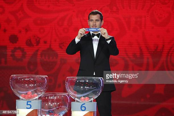 Russia's striker Alexander Kerzhakov shows the name of Kazakhstan during the preliminary draw for the Union of European Football Associations zone...
