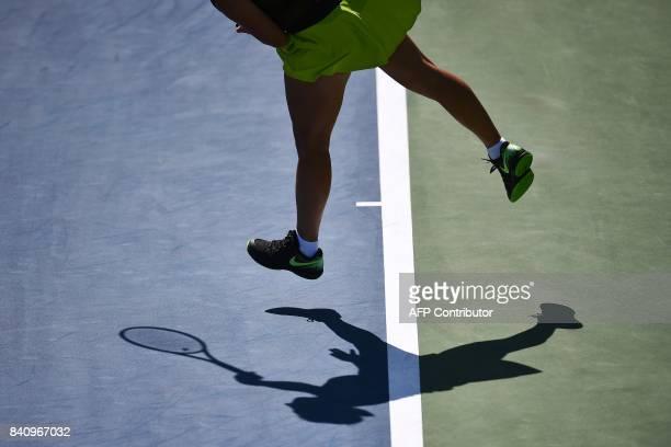 Russia's Svetlana Kuznetsova casts a shadow on the court as she serves the ball to Cezch Republic's Marketa Vondrousova during their 2017 US Open...