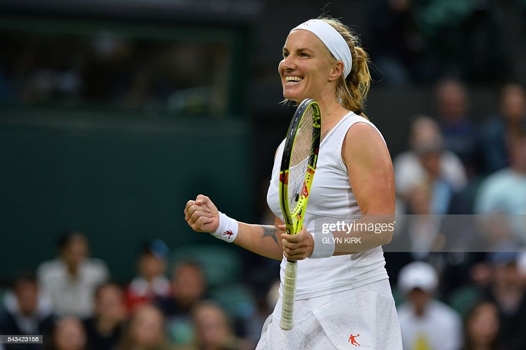 Russia's Svetlana Kuznetsova celebrates beating Denmark's Caroline Wozniacki during their women's singles first round match on the second day of the 2016 Wimbledon Championships at The All England Lawn Tennis Club in Wimbledon, southwest London, on June 28, 2016. / AFP / GLYN