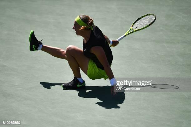 Russia's Svetlana Kuznetsova falls on the court as she returns the ball to Cezch Republic's Marketa Vondrousova during their 2017 US Open Women's...