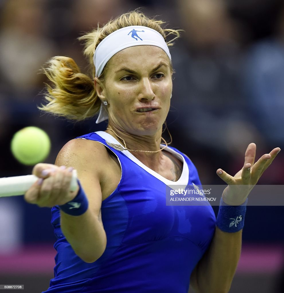 Russia's Svetlana Kuznetsova hits a return to Russia's Netherland's Kiki Bertens during the Federation Cup tennis world group first round match between Russia and Netherlands in Moscow on February 7, 2016. / AFP / ALEXANDER NEMENOV