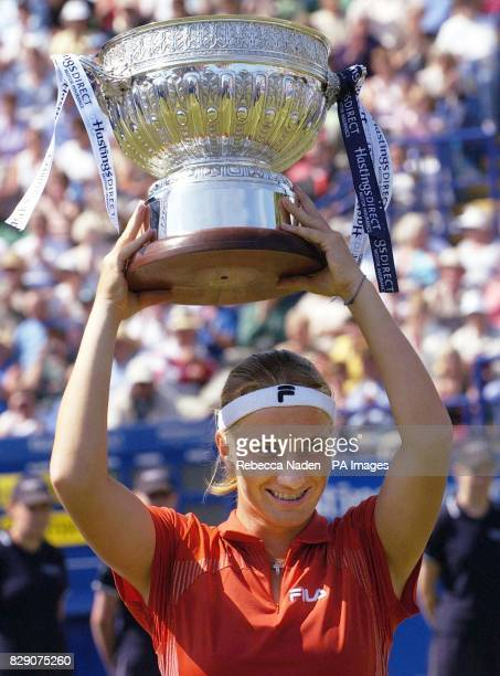 Russia's Svetlana Kuznetsova holds the trophy after winning the Hastings Direct International Championships at Devonshire Park Eastbourne Saturday...