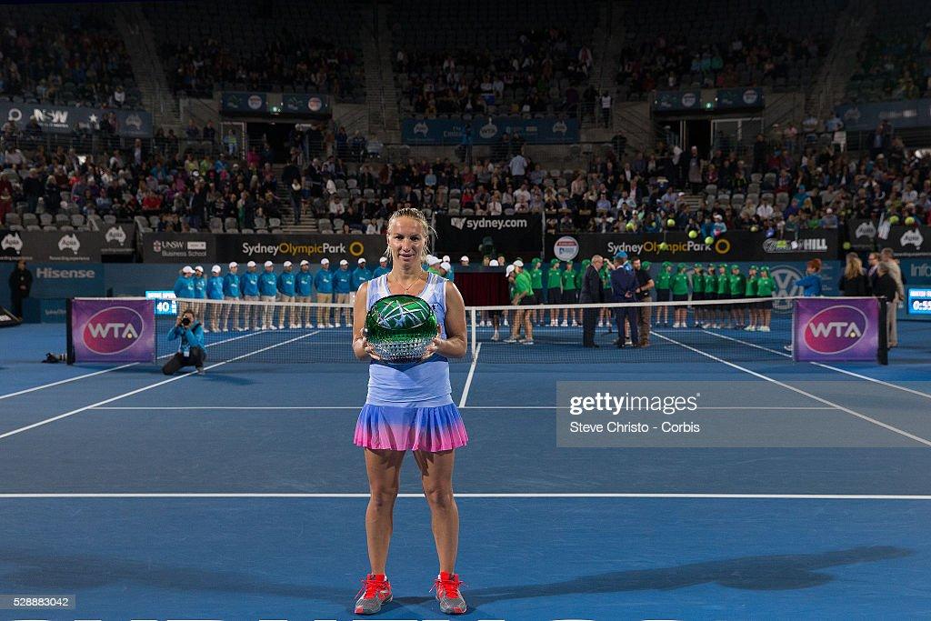 Russias Svetlana Kuznetsova Holds The Winners Trophy After Defeating Monica Puig Of Puerto Rico 6