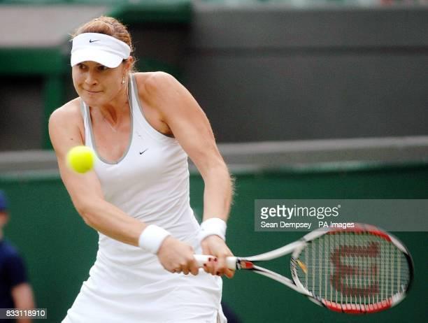 Russia's Svetlana Kuznetsova in action against Ukraine's Julia Vakulenko during The All England Lawn Tennis Championship at Wimbledon