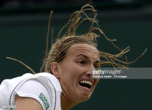 Russia's Svetlana Kuznetsova in action against USA's Venus Williams during The All England Lawn Tennis Championship at Wimbledon