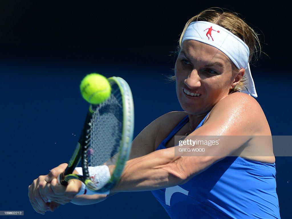 Russia's Svetlana Kuznetsova plays a return during her women's singles match against Denmark's Caroline Wozniacki on the eighth day of the Australian Open tennis tournament in Melbourne on January 21, 2013.