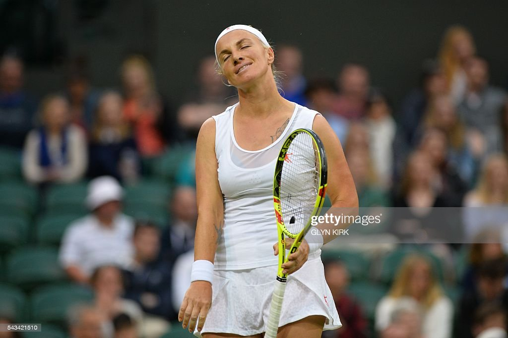 Russia's Svetlana Kuznetsova reacts after a point against Denmark's Caroline Wozniacki during their women's singles first round match on the second day of the 2016 Wimbledon Championships at The All England Lawn Tennis Club in Wimbledon, southwest London, on June 28, 2016. / AFP / GLYN