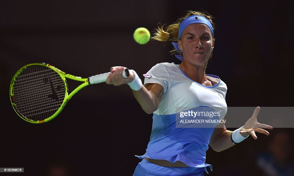 Russia's Svetlana Kuznetsova returns a service to Australia's Daria Gavrilova during the Kremlin Cup tennis tournament final match in Moscow on October 22, 2016. / AFP / ALEXANDER