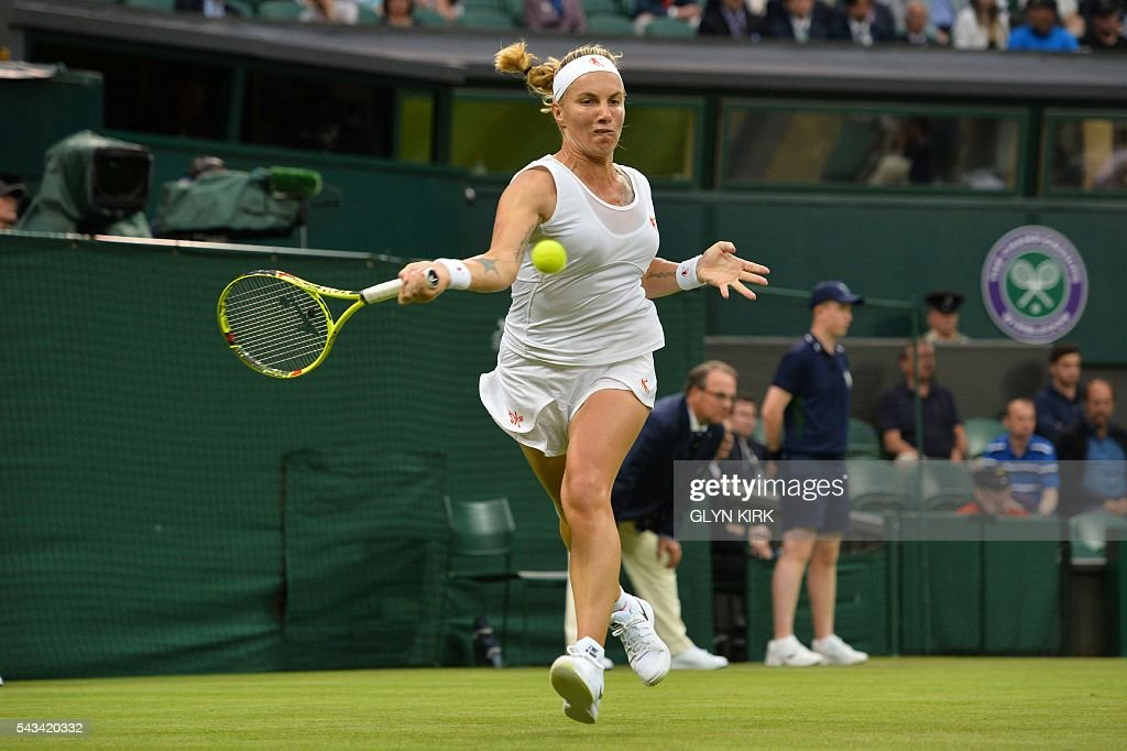 Russia's Svetlana Kuznetsova returns against Denmark's Caroline Wozniacki during their women's singles first round match on the second day of the 2016 Wimbledon Championships at The All England Lawn Tennis Club in Wimbledon, southwest London, on June 28, 2016. / AFP / GLYN