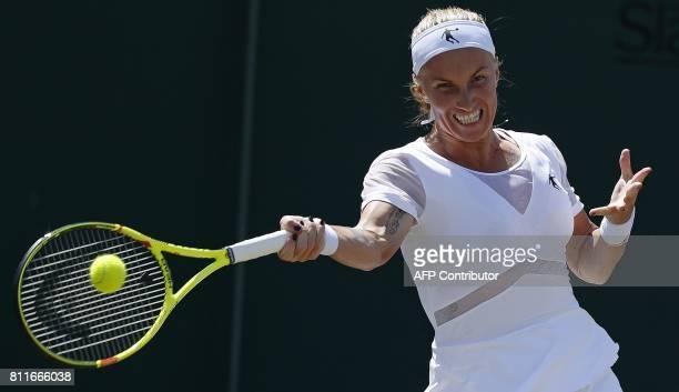 Russia's Svetlana Kuznetsova returns against Poland's Agnieszka Radwanska during their women's singles fourth round match on the seventh day of the...