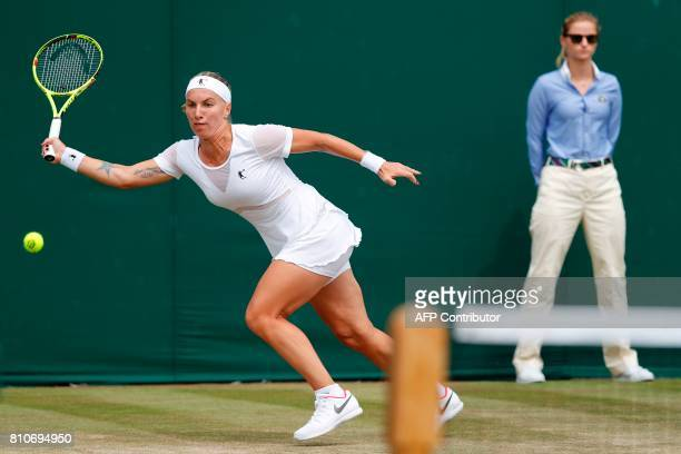 Russia's Svetlana Kuznetsova returns against Slovenia's Polona Hercog during their women's singles third round match on the sixth day of the 2017...