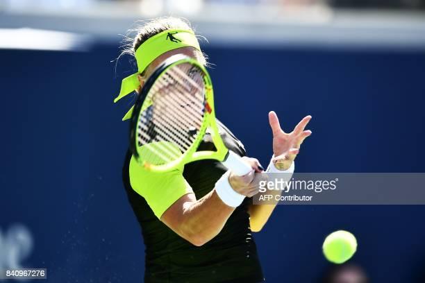 Russia's Svetlana Kuznetsova returns the ball to Cezch Republic's Marketa Vondrousova during their 2017 US Open Women's Singles match at the USTA...