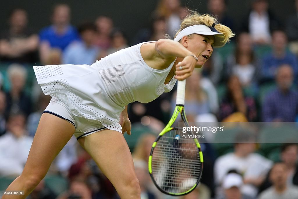 Russia's Svetlana Kuznetsova serves against Denmark's Caroline Wozniacki during their women's singles first round match on the second day of the 2016 Wimbledon Championships at The All England Lawn Tennis Club in Wimbledon, southwest London, on June 28, 2016. / AFP / GLYN