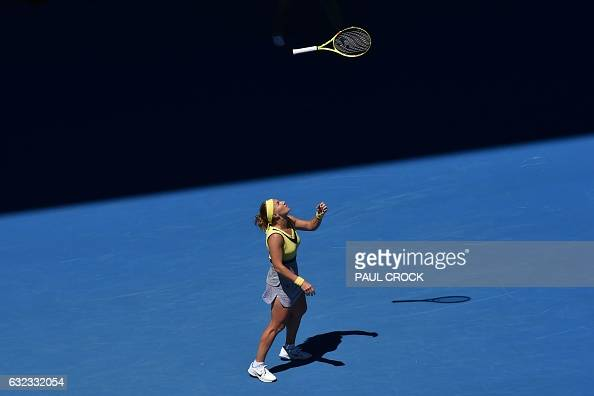 TOPSHOT Russia's Svetlana Kuznetsova throws her racquet during her women's singles fourth round match against Russia's Anastasia Pavlyuchenkova on...