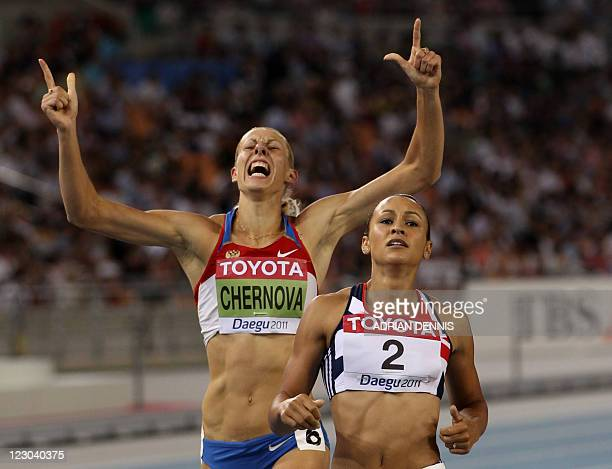 Russia's Tatyana Chernova celebrates behind Britain's Jessica Ennis at the end of the 800 metres of the women's heptathlon event at the International...