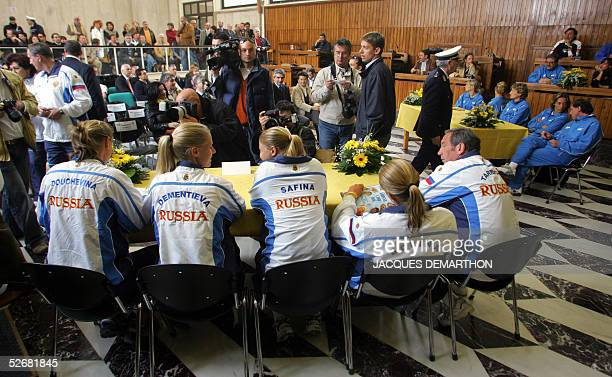 Russia's team and title holders Vera Douchevina Elena Dementieva Dinara Safina Elena Bovina and captain Shamil Tarpischev are pictured at the city...