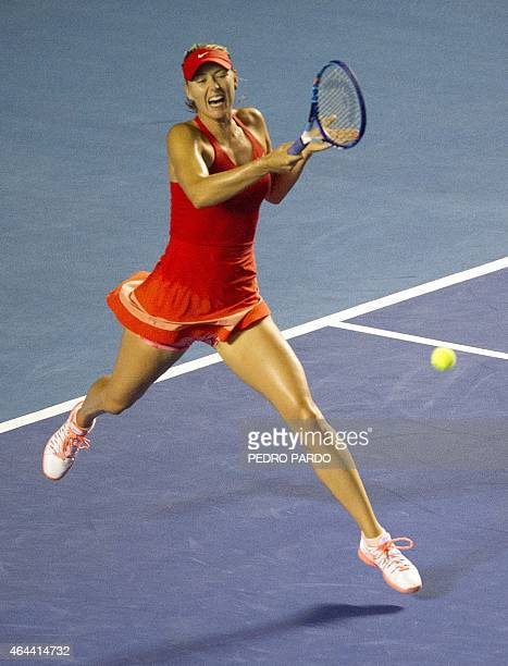 Russia's tennis player Maria Sharapova returns the ball to Mariana Duque of Colombia during their Mexico WTA tournament in Acapulco Guerrero State on...