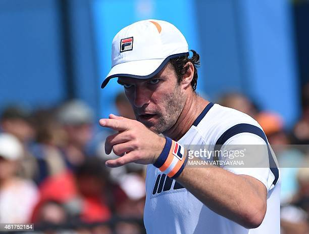 Russia's Teymuraz Gabashvili gestures during his men's singles match against Cyprus's Marcos Baghdatis on day one of the 2015 Australian Open tennis...