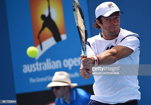 Russia's Teymuraz Gabashvili plays a shot during his men's singles match against Cyprus's Marcos Baghdatis on day one of the 2015 Australian Open...