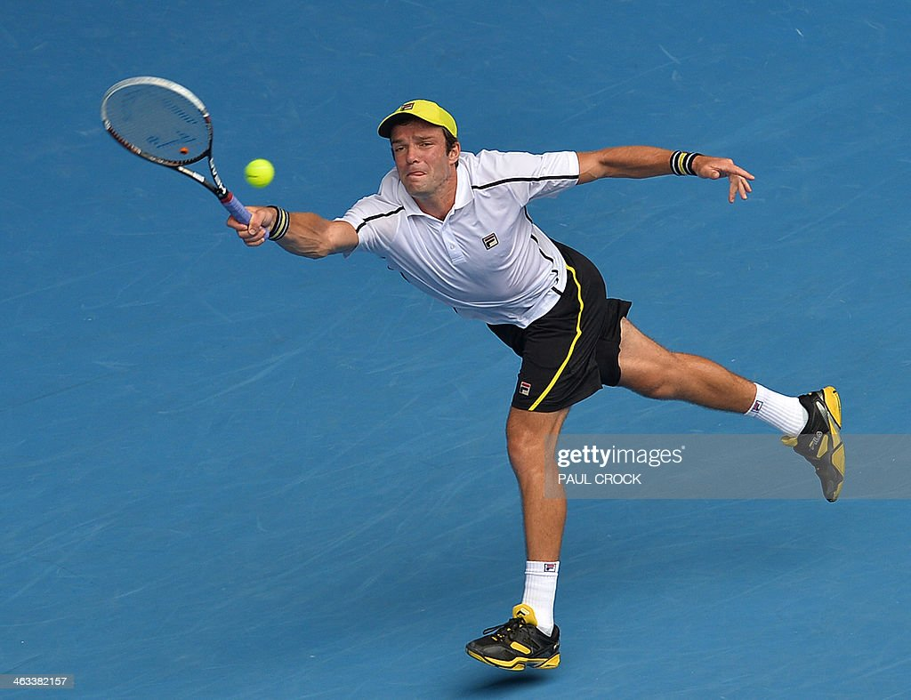 Russia's Teymuraz Gabashvili plays a shot during his men's singles match against Switzerland's Roger Federer on day six of the 2014 Australian Open tennis tournament in Melbourne on January 18, 2014. IMAGE RESTRICTED TO EDITORIAL USE - STRICTLY NO COMMERCIAL USE AFP PHOTO / PAUL CROCK