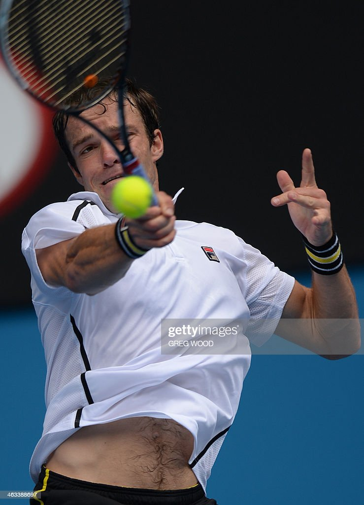 Russia's Teymuraz Gabashvili plays a shot during his men's singles match against Switzerland's Roger Federer on day six of the 2014 Australian Open tennis tournament in Melbourne on January 18, 2014. IMAGE