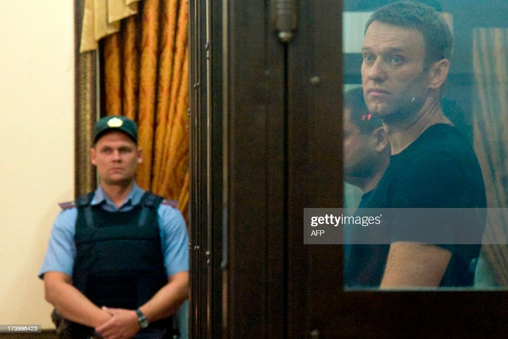 Russia's top opposition leader Alexei Navalny stands in the courtroom in Kirov on July 19, 2013. A Russian court on Friday unexpectedly freed protest leader Alexei Navalny pending his appeal against a five-year sentence on embezzlement charges, after his jailing prompted thousands to take to the streets in protest. The judge in the northern city of Kirov ruled that keeping President Vladimir Putin's top opponent in custody would deprive him of his right to stand in mayoral elections in Moscow on September 8.