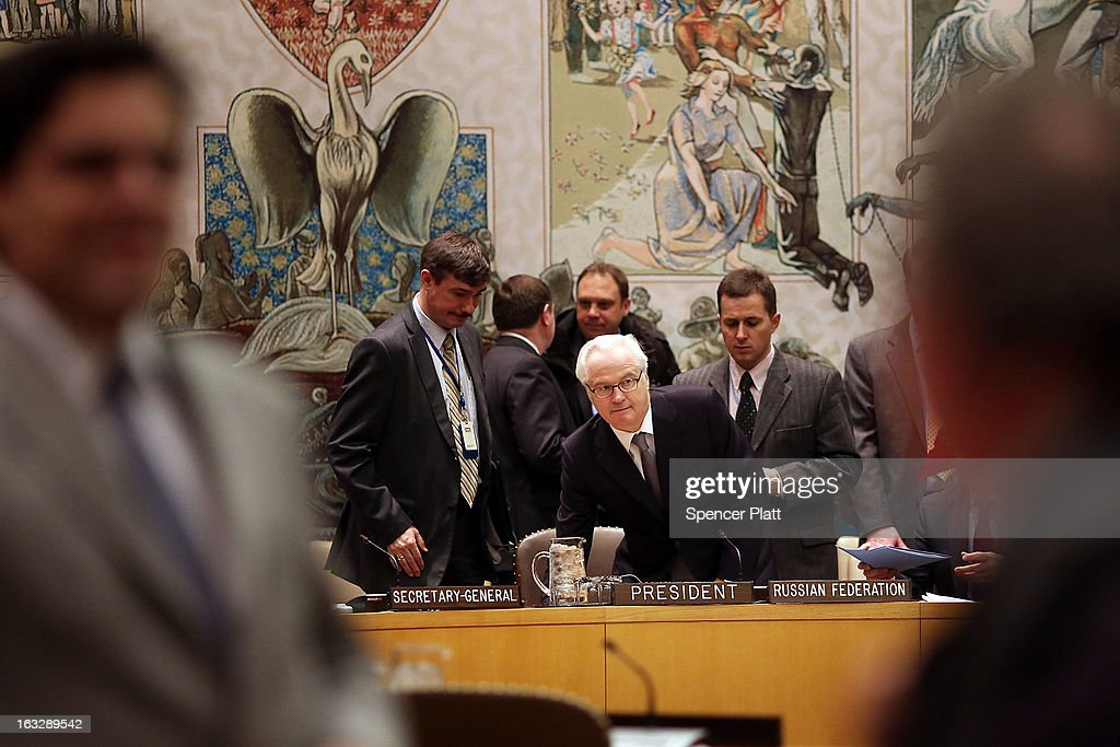 Russia's U.N. Ambassador Vitaly Churkin (C), the current council president, prepares to vote at a U.N. Security Council meeting on imposing a fourth round of sanctions against North Korea in an attempt to halt its nuclear and ballistic missile programs on March 7, 2013 in New York City. North Korea vowed today to launch a preemptive nuclear strike against the United States.