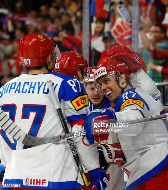 Russia's Vadim Chipatchiov Dmitri Orlov and Nikita Gusev celebrate a goal against Canada during the IIHF Men's World Championship Ice Hockey...
