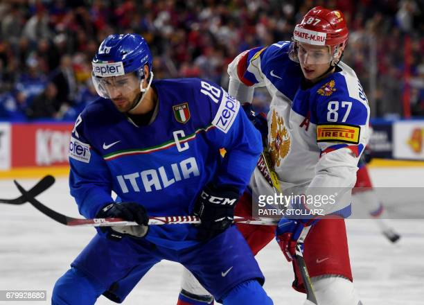 Russia´s Vadim Shipachyov and Italy´s Anton Bernard vie for the puck during IIHF Ice hockey world championship first round match between Russia and...