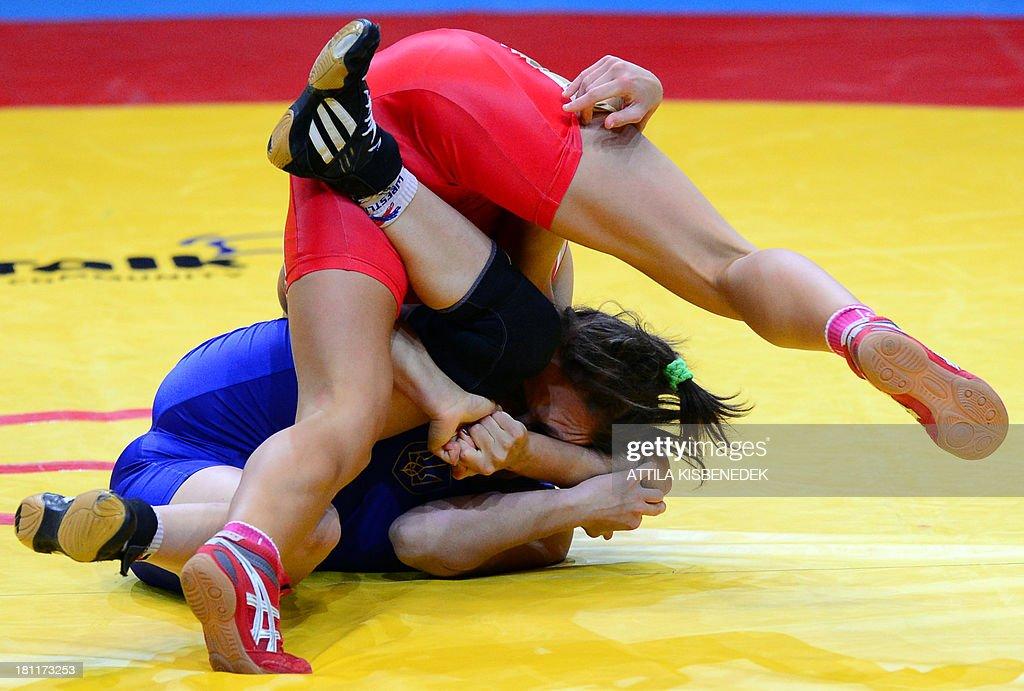 Russia's Valeriia Koblova (red) and Ukraine's Iryna Husyak (blue) fight during the women's free style 55 kg category for bronze of the FILA World Wrestling Championships in Budapest on September 19, 2013. Koblova won te bronze medal.