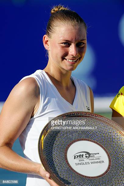 Russia's Vera Zvonareva holds the winner's trophy after she defeated India's Sania Mirza in the final of the Pattaya Tennis Open in Pattaya on...