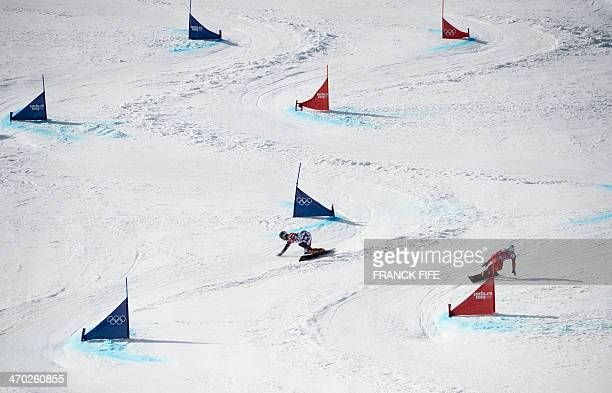 Russia's Vic Wild and Switzerland's Nevin Galmarini compete in the Men's Snowboard Parallel Giant Slalom Final at the Rosa Khutor Extreme Park during...