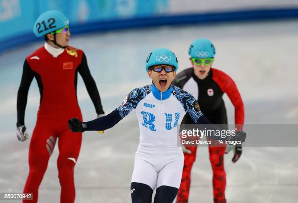 Russia's Victor An celebrates winning the Men's 500m Short Track at the Iceberg Skating Palace during the 2014 Sochi Olympic Games in Sochi Russia