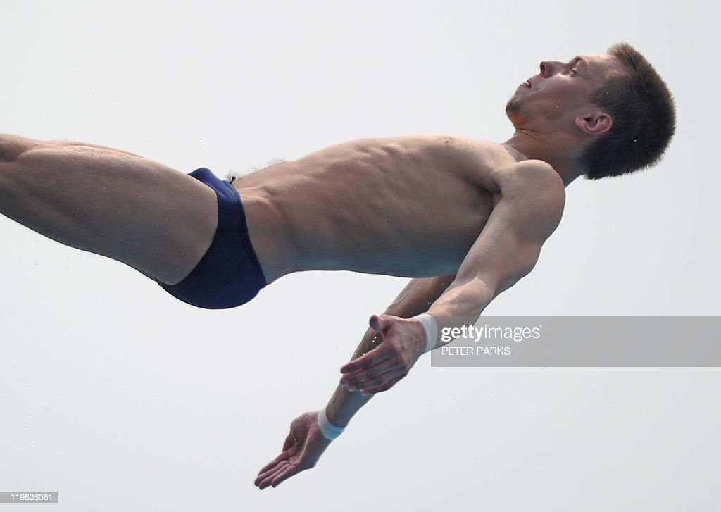 Russia's Victor Minibaev competes in the semi-final of the men's 10-metre platform diving event in the FINA World Championships at the outdoor diving pool of the Oriental Sports Centre in Shanghai on July 23, 2011.