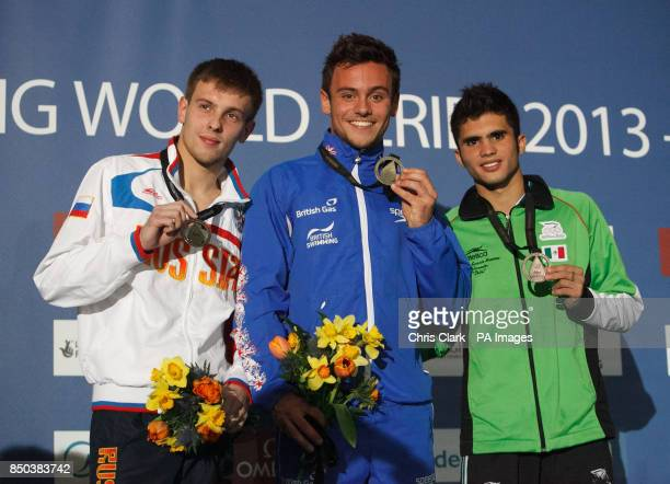 Russia's Victor Minibaev with his silver medal Great Britain's Tom Daley with his gold medal after victory in the Men's 10m Platform and Bronze...