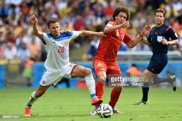 Russia's Viktor Fayzulin battles for the ball with Belgium's Axel Witsel