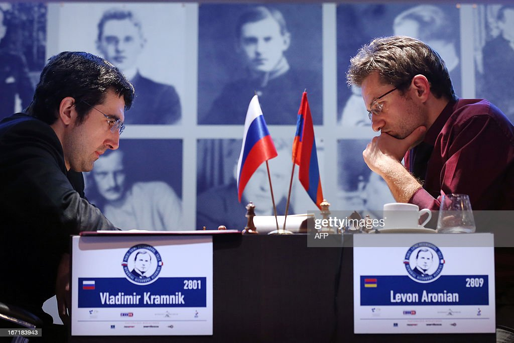 Russia's Vladimir Kramnik (L) and Armenia's Levon Aronian play during a round 2 game of the Alekhine Memorial chess tournament on April 22, 2013 in Paris. The tournament is a 10-player single round competition, with the first half held in Paris from April 20 to 25, and the second half in the Russian State Museum in St. Petersburg from APril 26 to May 1st.