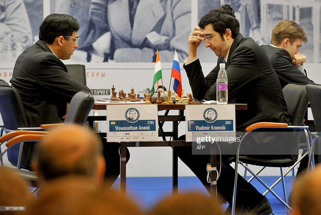 Russia's Vladimir Kramnik (R) and India's world champion Viswanathan Anand play during a round 6 game of the Alekhine Memorial chess tournament in St.Petersburg, on April 28, 2013. The tournament is a 10-player single round competition, with the first half held in Paris from April 20 to 25, and the second half in the Russian State Museum in St. Petersburg from April 26 to May 1st. AFP PHOTO / OLGA MALTSEVA