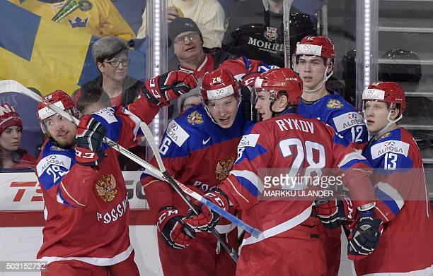 Russia's Yegor Korshkov celebrates with his teammates the 10 goal during the 2016 IIHF World Junior Ice Hockey Championship quarterfinal match...
