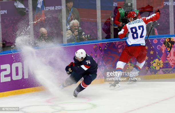 Russia's Yevgeni Medvedev and USA's TJ Oshie in their Preliminary Round match during the 2014 Sochi Olympic Games in Krasnaya Polyana Russia
