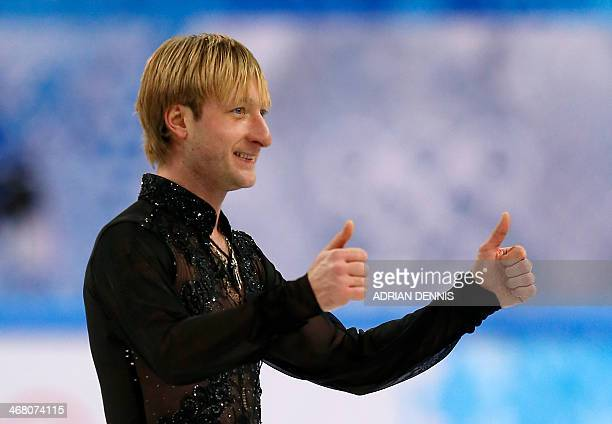 Russia's Yevgeni Plushenko celebrates after performing in the Men's Figure Skating Team Free Program at the Iceberg Skating Palace during the Sochi...