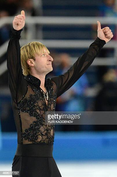Russia's Yevgeni Plushenko reacts after performing the Men's Figure Skating Team Free Program at the Iceberg Skating Palace during the Sochi Winter...