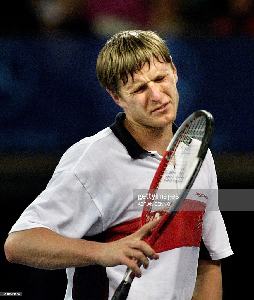 Russia s Yevgeny Kafelnikov grimaces on the court