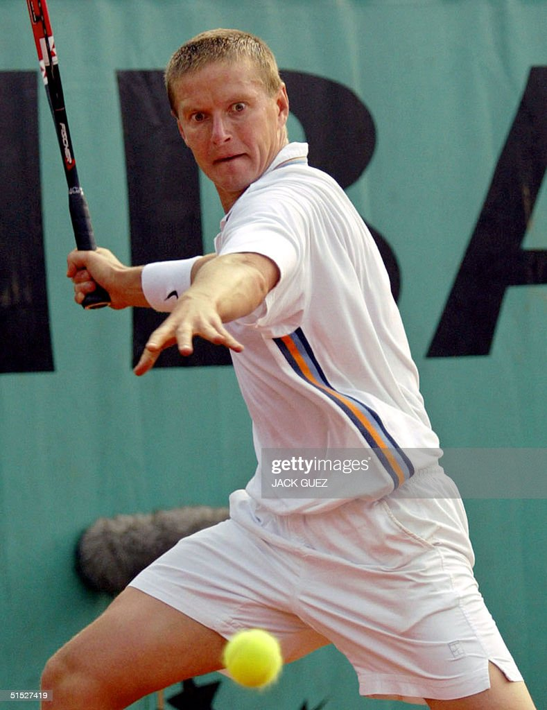 Russia s Yevgeny Kafelnikov hits a forehand to his