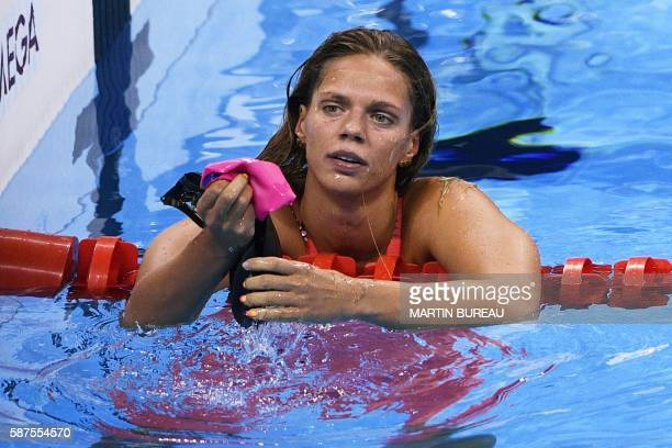 TOPSHOT Russia's Yulia Efimova looks dejected after placing second in the Women's 100m Breaststroke Final during the swimming event at the Rio 2016...