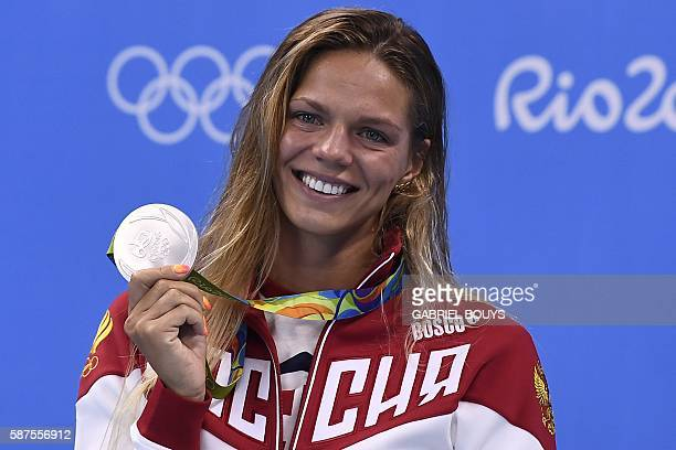 TOPSHOT Russia's Yulia Efimova poses with her silver medal on the podium of the Women's 100m Breaststroke during the swimming event at the Rio 2016...